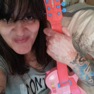 Dolly Sen with hello kitty guitar